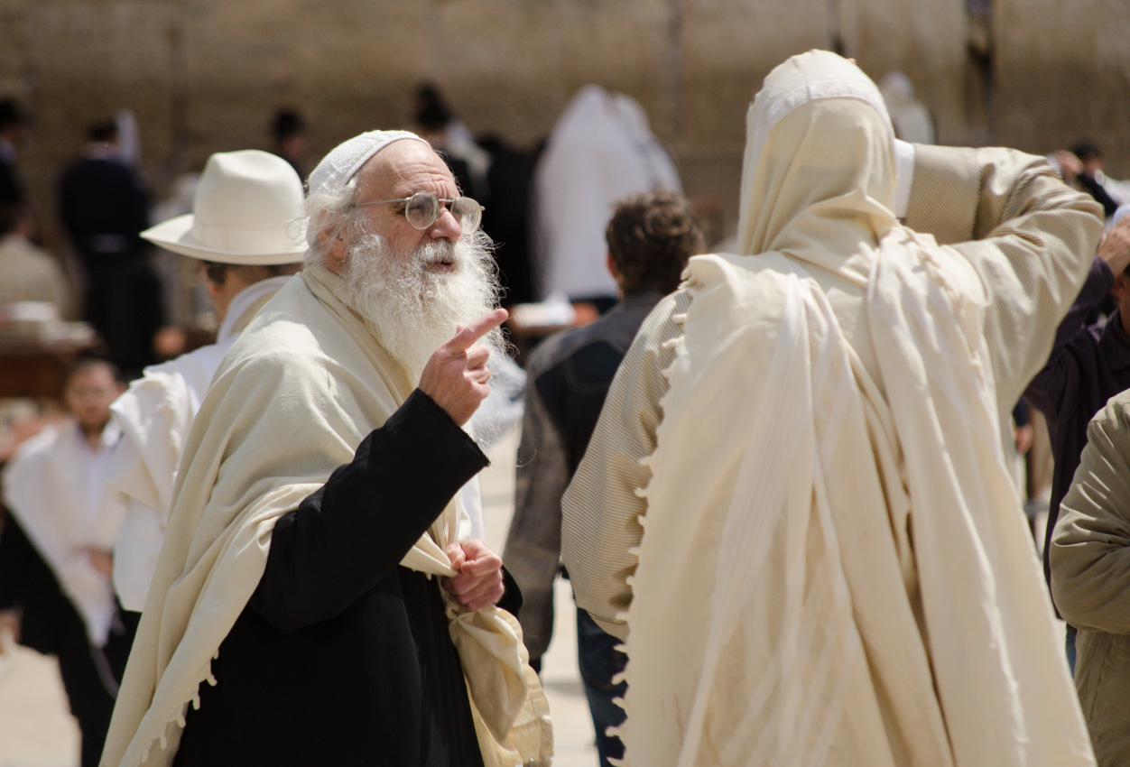 Jewish old men at the Western Wall in Jerusalem