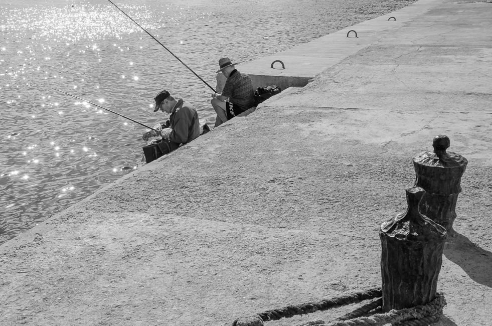Valletta,MALTA -CIRCA OCTOBER, 2015- Two people fishing near Valletta Old City