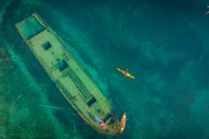 Shipwreck at Tobermory with kayakers, aerial view, Ontario, Canada