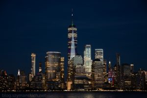 Lower Manhattan and One World Trade Center in New York City, USA as seen from  New Jersey durin night