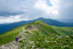 CHORNOHORA MOUNTAINS, UKRAINE   - JUNE 16, 2018 : People hiking in Ukrainian Chornohory  mountains during summer.
